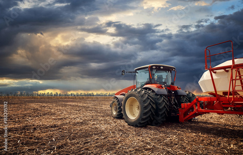 Foto Murales A powerful tractor works in the field