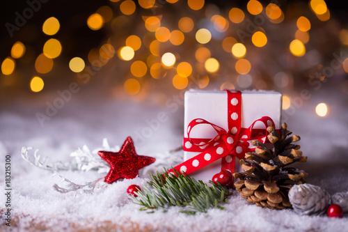 Fototapeta Christmas gift in snow landscape