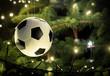 canvas print picture - Fussball hängt am Weihnachtsbaum, ideal für Fussballvereine, Nahaufnahme