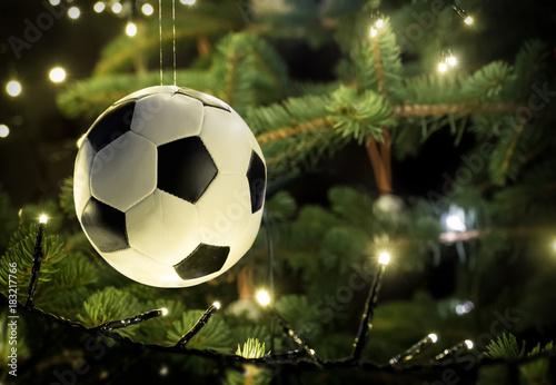 canvas print picture Fussball hängt am Weihnachtsbaum, ideal für Fussballvereine, Nahaufnahme