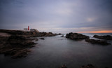 Long exposure from a lighthouse in a rocky beach in a cloudy winter day. Cascais, Portugal - 183218191