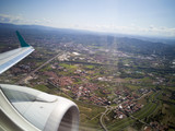Aerial view to Italian countryside from the airplane window. Wing with engine. - 183229132