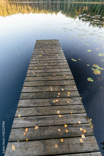 Aluminium Pier lake with water reflections in colorful autumn day