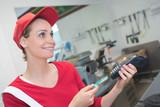 shopkeeper inserting a card in the machine - 183233743