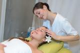 young attractive girl having head massage at spa resort - 183236995