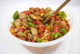 Delicious red souse from sausage, pepper and courgette in the ja - 183237184