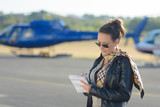 young businesswoman making plans on the tarmac - 183237737