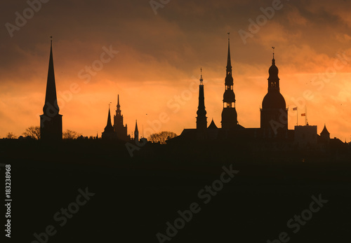 Fotobehang London City silhouette of Riga, Latvia in colorful morning sunset. Church towers and popular landmarks in background with stunning yellow sky.
