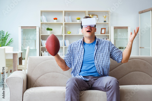 Plexiglas Voetbal Man wearing virtual reality VR glasses watching american footbal