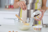 Cook sprinking ingredient into bowl - 183240109