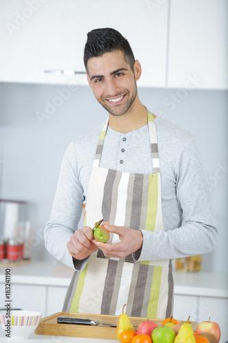 a man cutting apple