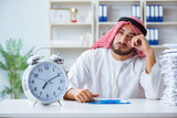 Arab businessman working in the office doing paperwork with a pi - 183245521