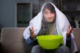 Sick man doing inhalation at night in home - 183245735