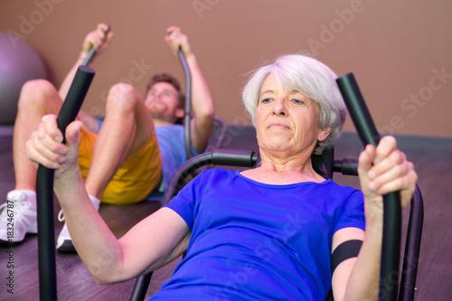 senior woman training in a gym