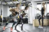 Fototapety Athletic girls training in gym