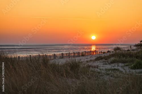 Aluminium Noordzee Sunset at Normandy beach