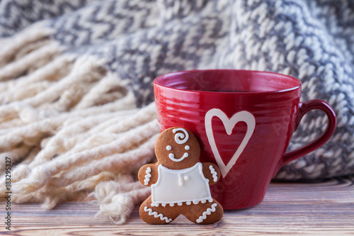 Foto op Plexiglas Chocolade hot chocolate with gingerbread man and cozy blanket