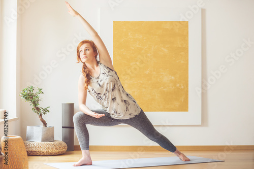 Naklejka Doing yoga in the morning