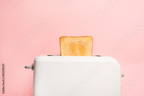 Aluminium Pop Art Healthy fashion food of breakfast. Toast in a toaster on a pink background.
