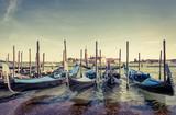 Berth with gondolas in Venice, Italy - 183298781