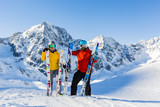 Happy family enjoying winter vacations in mountains. Playing with snow, Sun in high mountains. Winter holidays. - 183300123