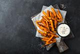 roasted sweet potato with garlic yogurt sause. - 183304314