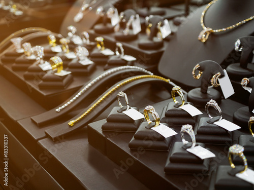 Gold jewelry diamond shop with rings and necklaces luxury retail store window display