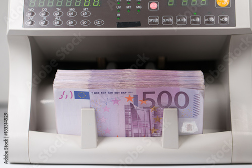 Poster five hundred euro banknotes in a counting machine