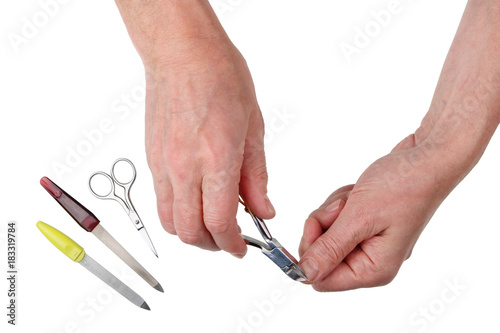 Foto op Plexiglas Manicure Elderly man cuts nails on fingers with the help of nippers and scissors
