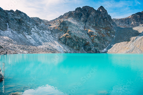 Beautiful blue alpine lake. Travels in the mountains