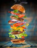 Big tasty burger with flying ingredients. - 183326945