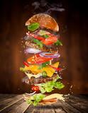 Big tasty burger with flying ingredients. - 183326977