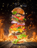 Big tasty burger with flying ingredients. - 183326979