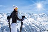 Beautiful brunette woman with ski - 183327725
