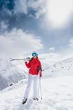 Beautiful brunette woman with ski - 183327944