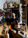 Senior sculptor working on his clay sculpture in his workshop. - 183331301