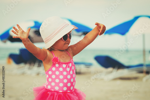 cute little girl play at summer beach