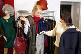 stylist helping chooses clothes for the customer