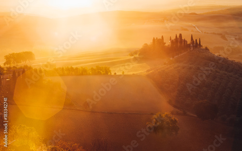 Papiers peints Toscane Tuscany, panoramic landscape with famous farmhouse rolling hills and valleys in beautiful golden morning light at sunrise in summer, Val d'Orcia, Italy