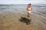 Family snorkeling with turtle  at the tropical coast of Sri Lanka - 183343315