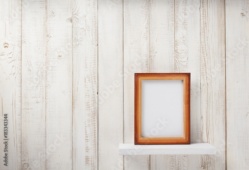 Fototapeta photo picture frame at wooden shel