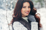 beautiful smiling young woman in wintertime outdoor. Winter concept - 183346395