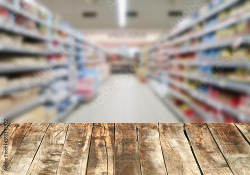 Wood board over blurred supermarket