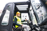 Woman forklift truck driver in an industrial area. - 183350166