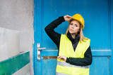 Woman worker standing outside a warehouse. - 183350997