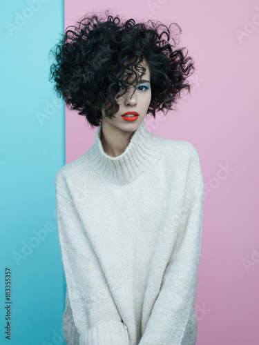 Tuinposter womenART Fashion portrait of beautiful asian woman in oversize pullover