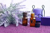 Bottles of essential oil, soap and candle with lavender - 183363938