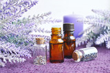 Bottles of essential lavender oil with flowers - 183364509