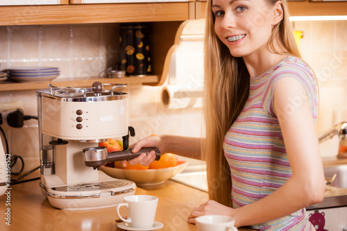 Sticker Woman in kitchen making coffee from machine