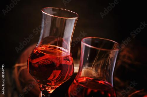 Kumquat drink, vintage wooden background, selective focus